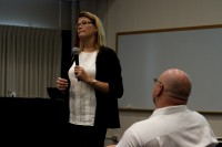 Ka La file photo >> College Chancellor Erika Lacro talks to students and faculty about the accreditation warning at a town hall last year in March.