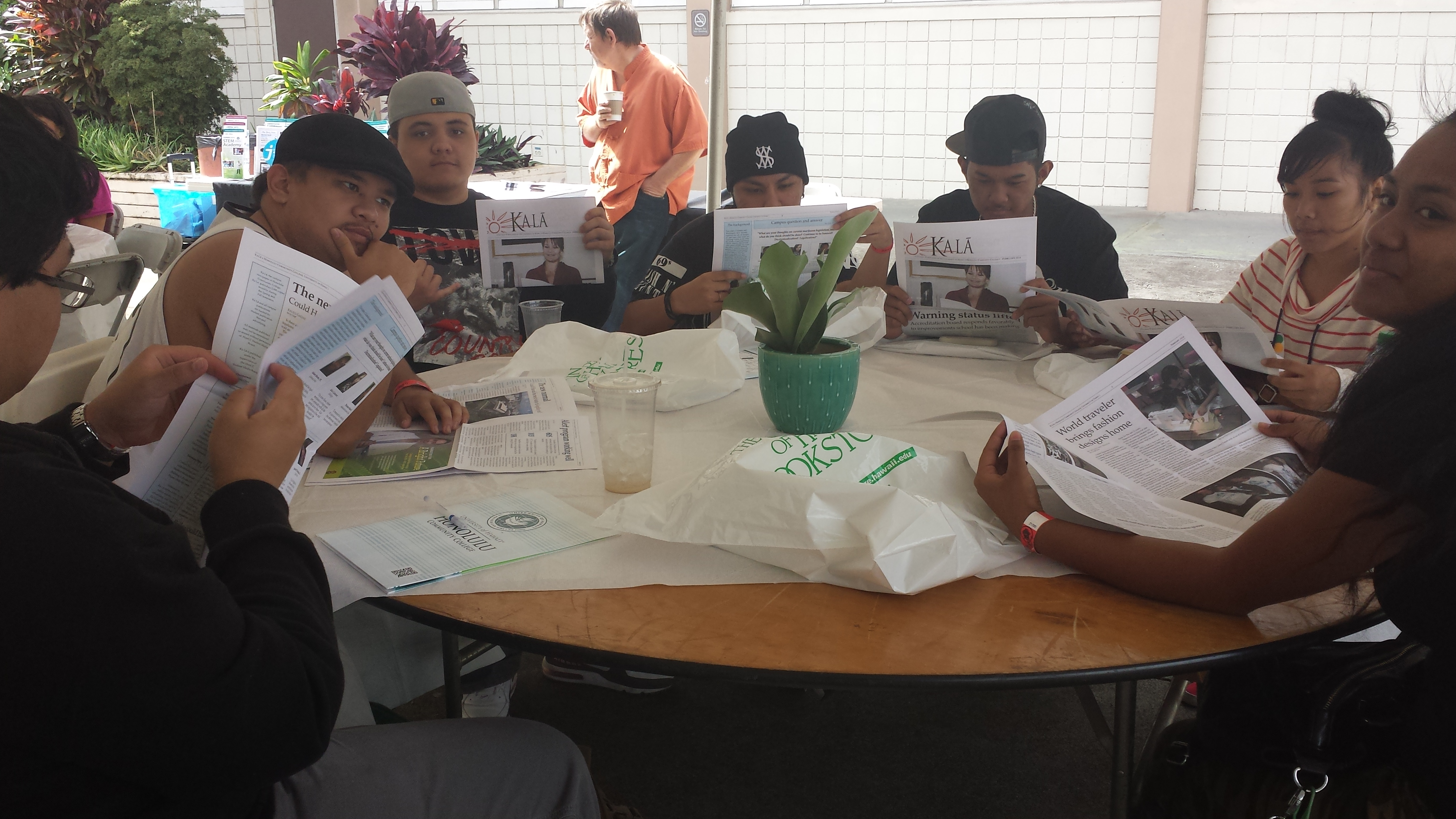 Visiting high school students read Ka La, the HCC student newspaper, during their visit to campus Tuesday.