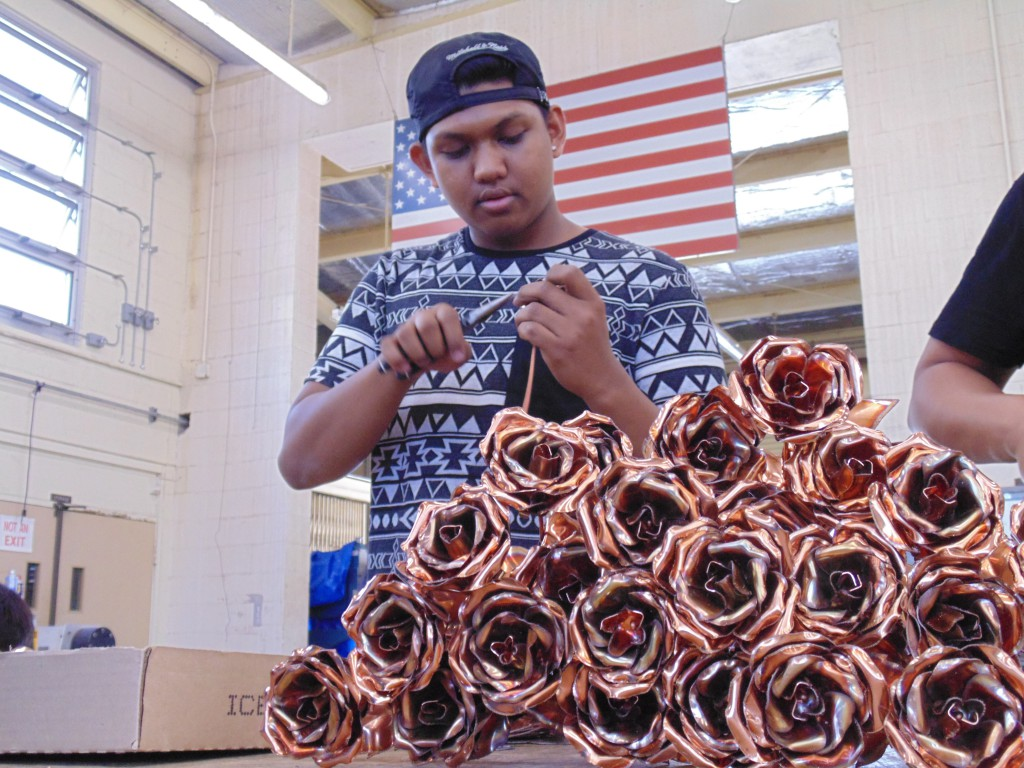 A student at Honolulu Community College makes one of the several hundred roses which will go on sale at 9:30 a.m. Friday.