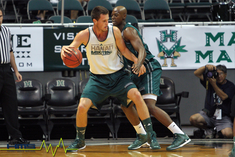 University Of Hawaii's F Mike Thomas (25) defends as C Stefan Jovanovic (15) brings the ball down during the University of Hawaii Rainbow Warrior Basketball Scrimmage on Saturday, Oct. 4th, 2014 at the Stan Sheriff Center in Honolulu, HI. (Photo by Andrew Lee / HMSWIRE)